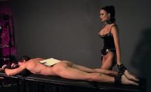 Busty mistress fucks strapped guy