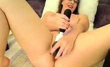 Young cam-girl toying tight pussy on webcam