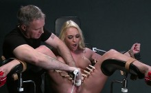 Busty blonde sub strapped in gyno chair