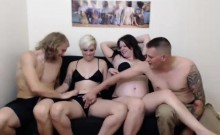 Two insatiable young couples having some fun together on th