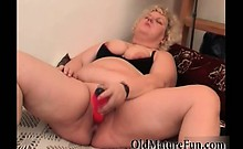 Big fat granny likes masturbate with red dildo