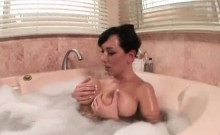 Horny milf touching her massive boobs in bath