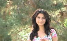Sunny awesome babe poses on web camera