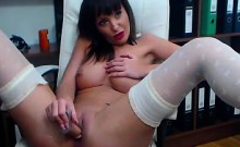 Hot milf in stockings fucks her pussy