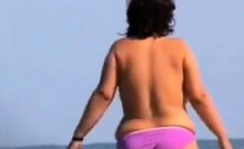 Thick Woman Wth Big Breasts At A Beach