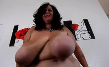 Voluptuous mature woman sets her massive hooters free for t