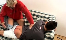 The blond boy might look submissive as he takes it, but