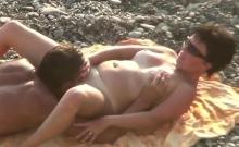 Husband cunnilingus mature wife on the beach