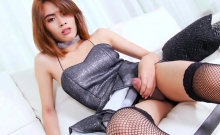 Small tits ladyboy shows off her firm ass and jerks off