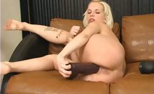 Megan rides a huge brutal dildo